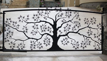 Custom metal driveway gate in the shape of a tree