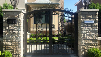 beautiful black metal custom gate leading into Burnaby home