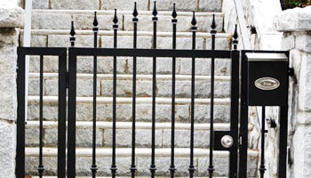 hinged black metal pedestrian gate