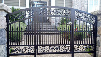 Ornate pedestrian security gate on west vancouver home