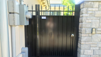 full privacy custom metal pedestrian gate leading into back yard